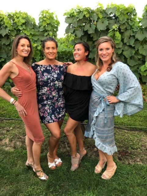SVP Melanie Klausner (far left) explored the vineyards of Long Island with friends
